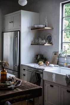 """I like the open shelving, the small dishwasher next to the sink.  the """"built-ins"""" around the refrigerator, the white and wood mixed together"""