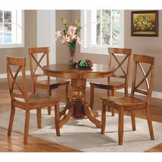 @Overstock.com - Cottage Oak 5-piece Dining Furniture Set - With this classic 5 piece dining room set, dinner parties with friends will be a classy and tasteful affair. This furniture set features a sociable round table in a cottage oak finish and four stylish cut out hardwood chairs.  http://www.overstock.com/Home-Garden/Cottage-Oak-5-piece-Dining-Furniture-Set/6626652/product.html?CID=214117 $431.65