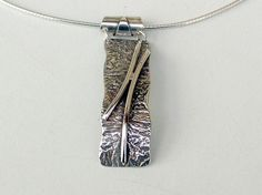 Reticulated sterling silver pendant.