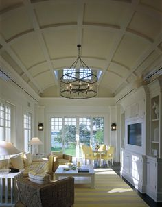 Shope Reno Wharton: Yellow and gray living room with barrel coffered ceiling with each ceiling coffer ...