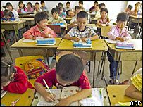 China ends school fees for 150m