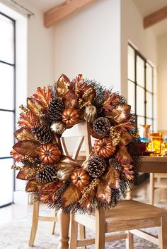 Pier 1's handcrafted Luxe Faux Gourd Metallic Wreath, composed of faux gourds, leaves, grass and natural pinecones, uses fall's favorite icons and enhances them with a metallic finish. The result is an elegant circle of beauty that's ready to greet your guests at your covered front door or brighten your mantel.