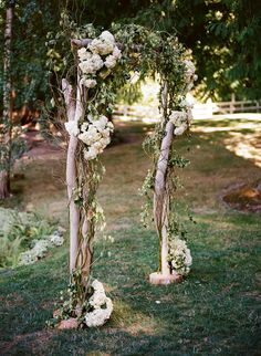 The bride and groom collected driftwood and constructed their own wedding arch. Awww... Real Wedding: Romantic Elegance by Rennard Photography - Belle the Magazine . The Wedding Blog For The Sophisticated Bride