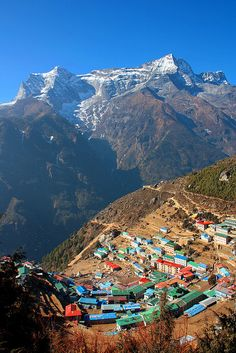 Looking down onto the village of Namche Bazaar from the highest airport in the world with Kongde Ri peak in the background, Sagarmatha Zone of north-eastern Nepal.