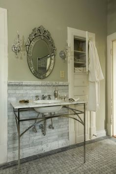 venetian glass mirror and marble. what's not to love?