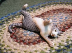 I googled 'tacky porcelain cat', and got this xD