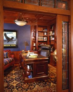 Traditional Home Office with Built-in bookshelf, Chair rail, Hardwood floors, Crown molding, flush light, Exposed beam