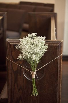 able to convert from pew flowers to bouquet for sign in table - babies breath along the pews