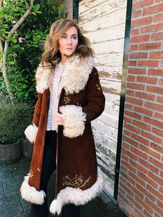 Vintage. Authentic 70s Afghan coat. Handmade. Beautiful burgundy color with golden floral embroidery. Two tone shearling. This coat is absolutely fabulous and, I kid you not, a total dream! Shoulder to shoulder: 16 in, 41 cm Armpit to armpit: 17 in, 43.5 cm Length of coat: 44 in, 112 cm
