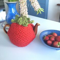 Knitted tea cozy, red strawberry teapot warmer is handmade with Australian yarn and a perfect gift idea for tea lovers.