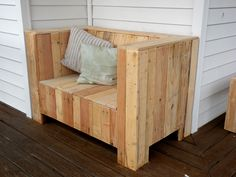 Pallet loveseat with flip-up seat for storage.