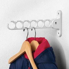 I need this in my laundry room so Robert will quit letting his dress shirts dry on the floor... (yes, we have a big drying rack!)