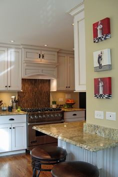 This remarkable kitchen has maple cabinets with for Fat chef kitchen ideas