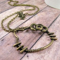 Bronze Hello Kitty necklace with tiny bronze bow