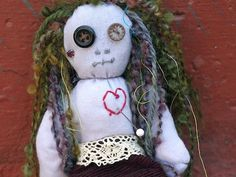 Voodoo Doll Pincushion...simple idea for a voodoo doll...another alternative to doll/ puppet of Poppy...love the embellishments on this one