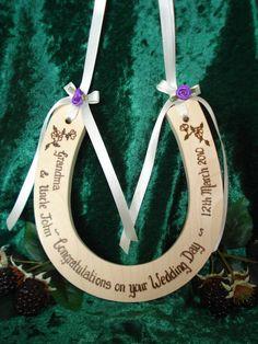 Personalised standard wedding horseshoe with white ribbons and purple rosebuds