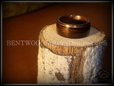 Copperline bentwood wooden ring is made from Macassar Ebony wood and a thin minimalist design using thin strip of copper Inlay. Every ring order includes: 1) A Bethlehem olivewood ring box laser engraved. 2) A durable crystalline buffing wax. 3) A care and maintenance reference card. 4) Ring(s) ordered handcrafted by me personally and my specific bentwood ring making process.  My bentwood rings are extremely durable, even with everyday normal daily wear. No other wood rings compare to the…
