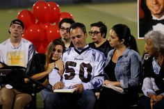 After speaking about his son, John Deming gets support from his daughter, Amber Deming, at left, and Merissa Lowe, during a memorial for John Deming Jr. at Piedmont Hills High School in San Jose, Calif., on Friday, July 17, 2015. (Jim Gensheimer/Bay Area News Group)