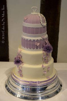 My only birdcage wedding cake on the books this year - themes were shades of lilac, birdcages and pearls.   The tiers were (from the bottom up): chocolate cake with vanilla buttercream filling; rich fruit cake; vanilla madeira with raspberry jam filling; and lemon madeira with lemon curd.  2nd cake in a row where I've had to travel with the whole thing stacked due to the design - thank goodness this one was close to home in York! And we managed to negotiate the obstacle course of stairs, ...