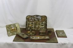 This set is absolutely beautiful. I wish stuff like this was still made! Tiffany Studios Grapevine bronze & Favrile 9-piece desk set (pen tray, inkwell, rocker blotter, calendar frame, letter holder, notepad, matchbox stand, pen wipe, & 4 blotter corners)