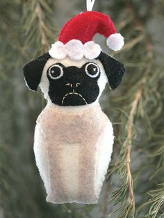 This adorable pug ornament is completely hand stitched and embroidery. Each of my ornaments is completely unique and different. It measures about