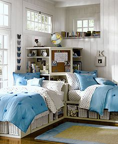 I would consider doing this with Rachel... Twin beds with storage in the corner.