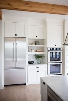 White cabinets and wood ceiling beam. Love this kitchen combination. White cabinets and wood ceiling beam. Love this kitchen combination. Double Oven Kitchen, Kitchen Oven, Ikea Kitchen, Kitchen Redo, Home Decor Kitchen, Kitchen Interior, Home Kitchens, Kitchens With Double Ovens, Ovens In Kitchens