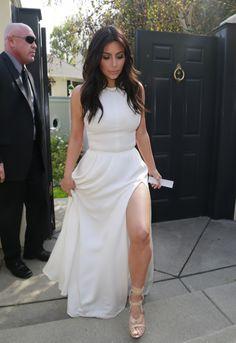 Kim Kardashian in high neck white long dress with a slit