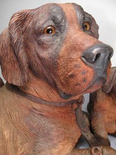 Black Forest Dog Carvings $30,500. | Content in a Cottage