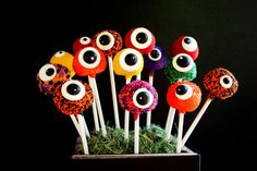 these aren't cookies, but made me think that you could make eyeball cookie pops for halloween! Would be fun for a party