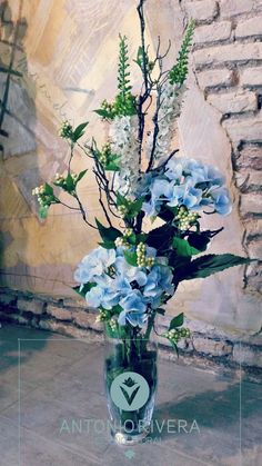 Floral arrangement light blue hues