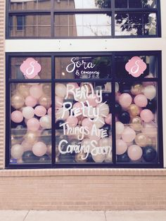 Sora & Company women's clothing boutique window display - opening soon