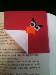 Angry Bird origami book mark basic instructions.  I used white paper and drew on the different birds' faces.  Play around with the final folds, and size of paper, to create various birds.
