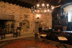 Medieval Living Room Ideas with Brick Wall Decor and Floral Red Rug jpg 1024×685 Medieval home decor Castle interior medieval Castles interior