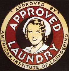 Round sign Approved by American Institute of Laundering with a picture in the center of a woman.