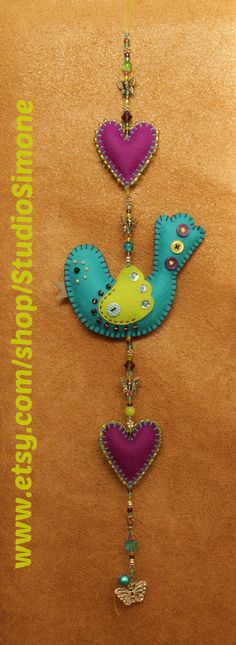 Lovely Luckybird and Happy Hearts garland with buttons, beads and bell.