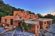 Time Travel: Abandoned Village Turned Hotel in Greece Nachhaltiges Design, Greece Hotels, Crete Island, Crete Greece, Beach Vacation Rentals, Stone Houses, Beautiful Places To Visit, Sustainable Design, Greek Islands