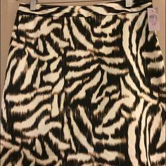 Ann Taylor Animal print skirt with pockets Ann Taylor fully lined rayon/cotton/spandex Ann Taylor Skirts Midi