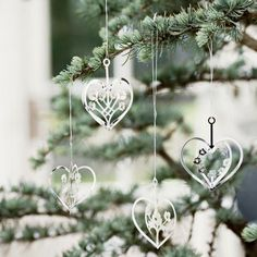 A boxed set of 4 intricate laser cut heart shaped decorations. Designed by Denmarks Jette Frolich.
