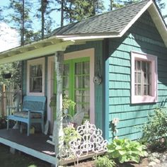 Guest cottage - turquoise shingles with orchid and lime trim colors. Lovely!