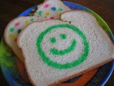 Mix 1 Tablespoon of milk with 4 drops of food coloring. Paint on bread! Toast and stays on. Loved doing this as a kid!!! Glad I found out how to do it!