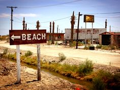 """Salton SEA, California, USA """"There is a place where beaches are made not of sand, but of the skeletons of millions of fish. Luxury yacht clubs are now frequented only by pigeons, vacation homes lay open to the elements and RV camp grounds look more like b Abandoned Buildings, Abandoned Places, Haunted Places, Salton Sea California, California Usa, Sea Photo, Beach Town, Ghost Towns, That Way"""