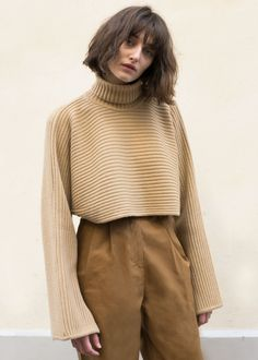 "Cropped, Horizontally Ribbed Sweater w/Elongated Sleeves & Slit Cuffs Color- Camel Brown 85% Wool, 15% Cashmere 13"" Length, 23"" Bottom Hem Width Dry Clean Imported"