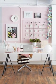 We simply can't get enough of this pastel pink, dream home office. With an erasable calendar on the wall and simple and functional decorations, this creative workspace is a beautiful balance of style and storage.