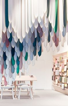 Stockholm Furniture Fair 2013 | Designed as Kvadrat's stand 'The Picnic'  features a wooden construction of Dinesen Douglas Fir and a textile  installation consisting of 1,500 straps made out of a selection of twenty  different Kvadrat fabrics.  Playing with such an amount of textiles a