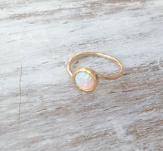 Beautiful gold filled ring with white opal gemstone.White shiny opal stone on a dainty hammered gold filled ring.Super dainty style- chic and beautiful.The price for this 1 ring !Also available with blue opal.Stone size 6 mm Please pick your size ring! Rose Gold Engagement Ring, Vintage Engagement Rings, White Gold Opal Ring, Silver Ring, Opal Jewelry, Opal Earrings, Jewelry Rings, Stone Jewelry, Gemstone Rings