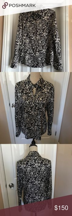 """St. John shirt silk 8 M blouse top black cream Gorgeous St. John silk blouse ! ✨ pretty black and light white cream print  ✨ black silver signatures buttons in front and signature buttons on cuffs ✨ collar neck ✨ size 8 or M , bust 20"""" pit to pit, length 27"""" ✨ 95 silk 5 spandex for comfort ✨ perfect for office or casual, dinner, travel etc ✨ like new, never worn St. John Tops Button Down Shirts"""