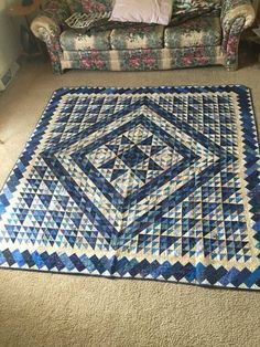 """By Alice Zeman. """"Blue Medallion is one of the two most favorite quilts I have ever done. It was the second scrap quilt I made. It was pieced in 1997 but I couldn't decide what kind of border for it until 2004 when I saw a border by Sharon Craig which was perfect. The quilt was designed by Kathleen McCrady and was in """"Quilters Newsletter Magazine"""" in July-Aug 1988."""""""