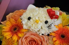 Hello Kitty flower bouquet.  I want a Hello Kitty flower in my bouquet!  How adorable is that!?