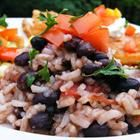 Quick Black Beans and Rice Recipe  Usually I make this with regular, white rice and adjust the water to what the rice calls for. I also add a little cumin and (Mexican) chili powder. It usually takes 45 minutes or more, but definitely worth it!